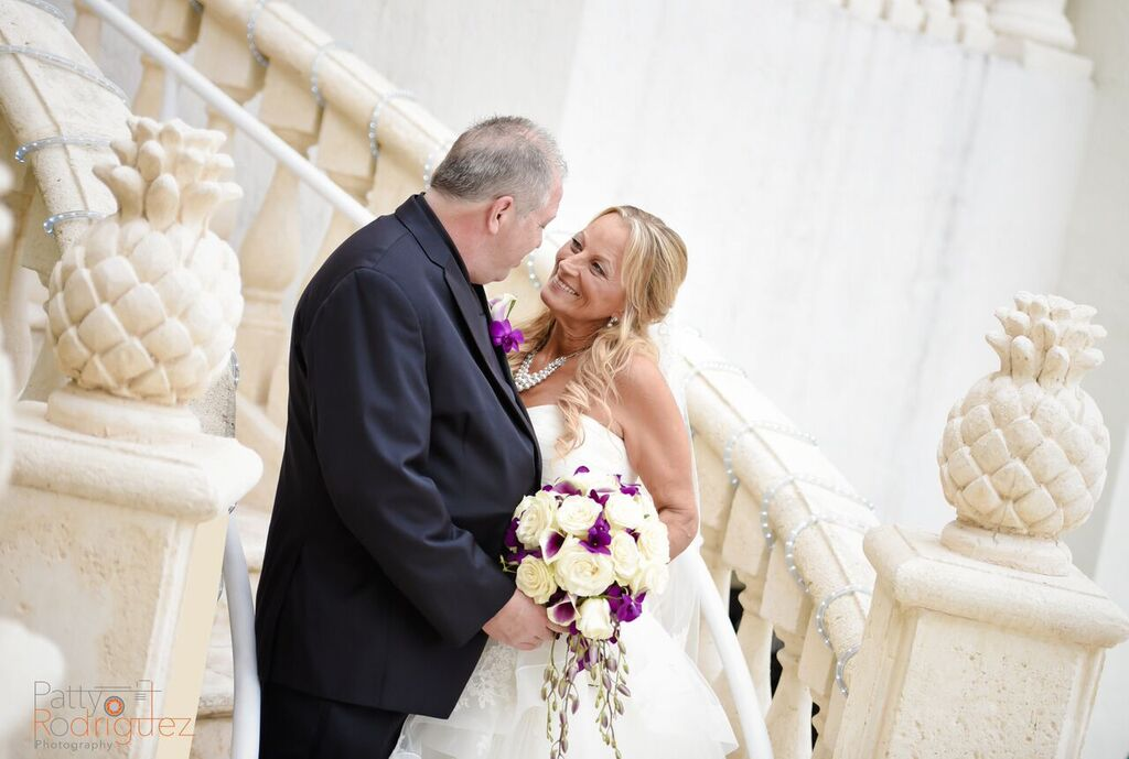 Intimate moment between bride and groom at the entrance of the floridian ballroom.
